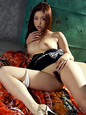 Risa Kasumi Asian in fishnets shows nude tits and hairy cooter