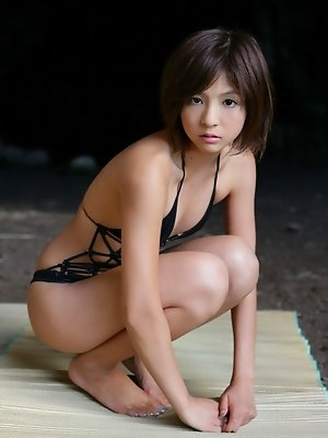 Short haired asian babe has small perky tits in a pink bikini