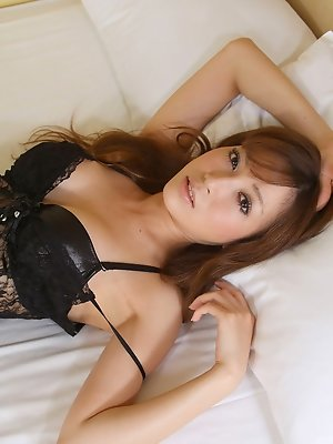Gorgeous asian beauty in black lingerie and fish net stockings