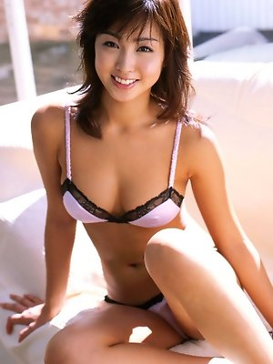 Beautiful asian babe showing off her stacked body in lingerie