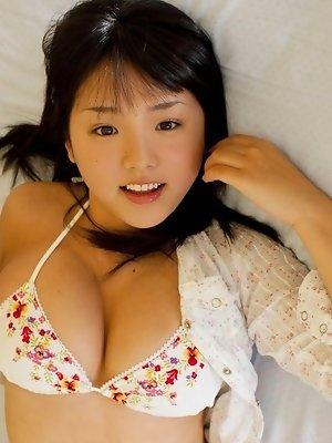 Ai Nanase looking very cute in her flower print bikini